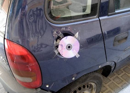 CD taped on car to replace missing gas cap