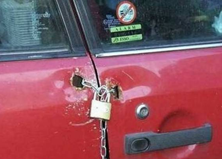 Chain and padlock used to hold car door shut