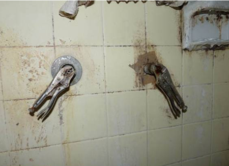 Pipe wrenches replacing shower faucet handles