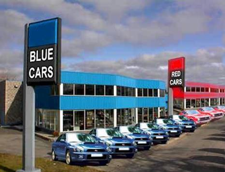 Car lot with nothing but red and blue cars
