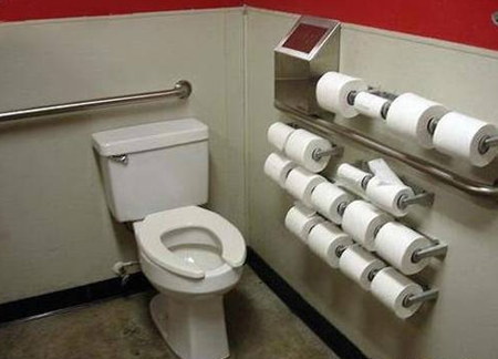 Bathroom with dozens of toilet paper rolls