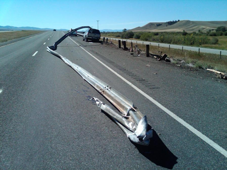 Car shaves guardrail right off