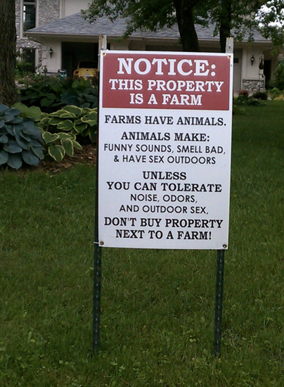 Funny farm sign - don't buy this property if you don't like outdoor sex