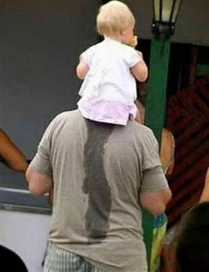 Father carrying child who wet on his back