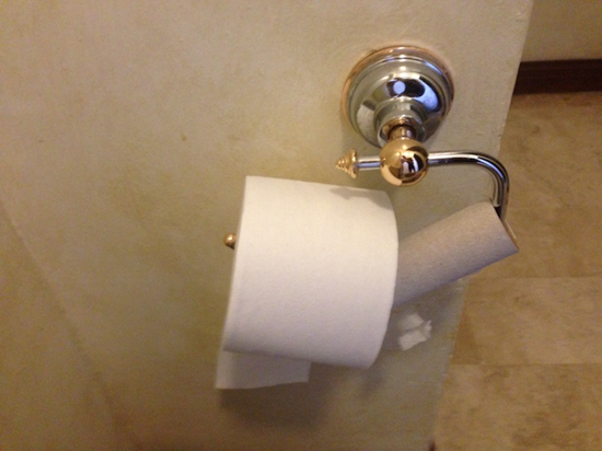 Toilet paper roll on empty toilet paper roll