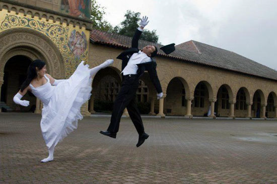 Wedding photo - wife karate kicks new husband