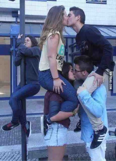 Girl kissing a pole