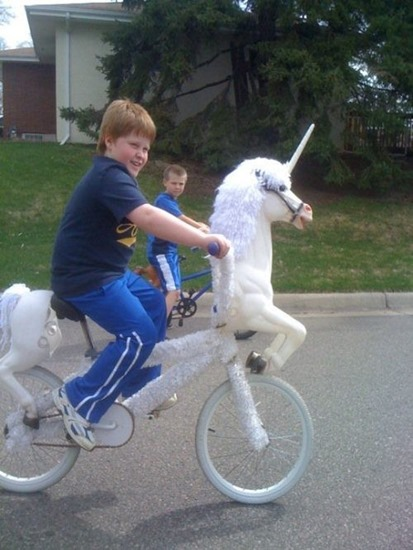 Boy on unicorn bicycle