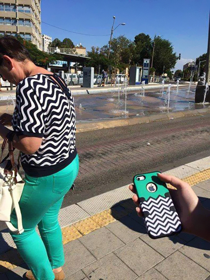 Cellphone case matches lady's pants and shirt